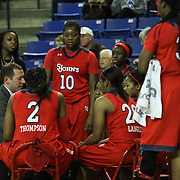 St. John's Women's Head Coach Joe Tartamella (Left) directs his team during a timeout in the second half of a NCAA regular season non-conference game between Delaware (CAA) and St. John's (Big East) Monday, Dec 30, 2013 at The Bob Carpenter Sports Convocation Center in Newark Delaware.