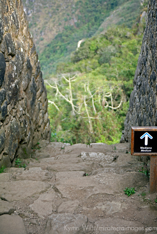 South America, Peru. Sign points the way to nowhere at Machu PIcchu, a UNESCO World Heritage Site.