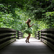 Alex Sele, 16, of Sequim twirls in her dress in the middle of the elevated Olympic Discovery Trail at Railroad Bridge Park on June 3 2007 Sequim.  Sele was showing off her dress to a friend.  Photo by Joshua Trujillo / Seattle Post-Intelligencer