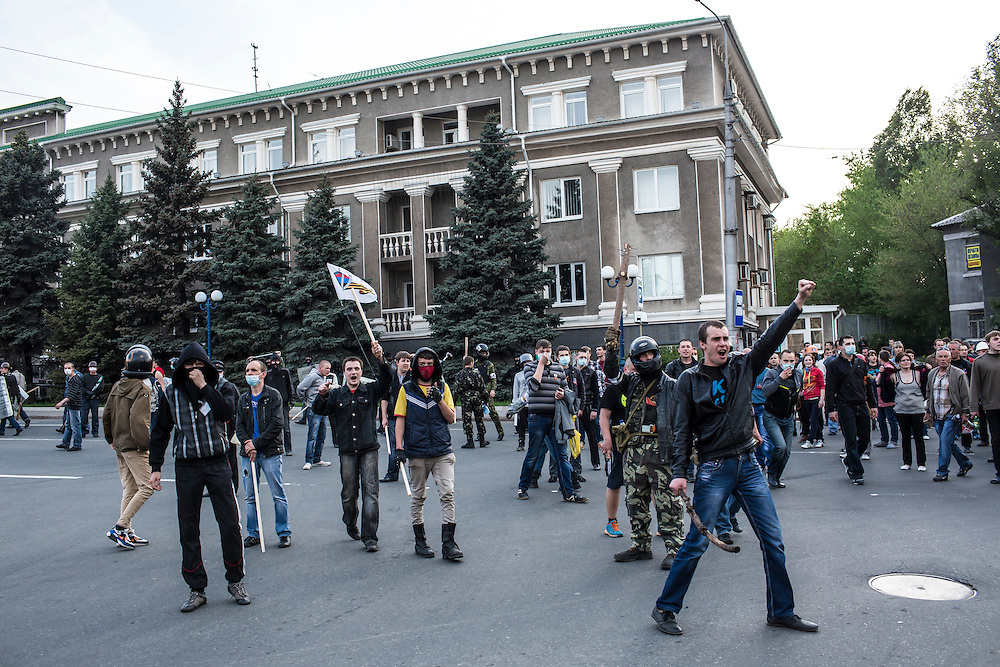 DONETSK, UKRAINE - MAY 4: Pro-Russian protesters march toward the military prosecutor's office on May 4, 2014 in Donetsk, Ukraine. Cities across Eastern Ukraine have been overtaken by pro-Russian protesters in recent weeks, leading the Ukrainian military to respond with force in some areas. (Photo by Brendan Hoffman for The Washington Post)
