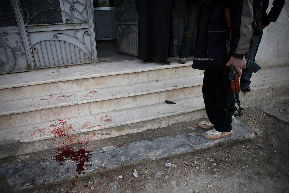 Blood on the stairs inside the mosque of Kureen. On 22. February the syrian army attacked the village of Kureen, Province of Idlib, Syria. Kureen was among the first villages in the northwest of Syria controlled by the opposition. Some villagers and members of the defence units escaped to surrounding olive orchards, when the attack begun in the early morning. A majority of the inhabitants didn´t manage to escape. The heavy shelling lasts 7 houres. Soldiers searched all houses, burnt some of them down, loote shops, stole cars and furniture. About 60 motorcycles were burnt down. Tanks demolished several houses. 6 men were executed. One woman died as a result of an heart attack.