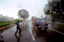 These pictures of Jakarta were taken during the fall of President Suharto. The photos are from a larger study of work about the city itself. <br /> Just after the 2nd World War urban population grew steadily to 30% but more recently with the many changing states of human interaction via globalization etc, an unprecedented urban growth has arisen where 47% of the Worlds population now live in urban environments. To date there are over 400 cities around the World with over 1 million people. <br /> The largest of the Worlds cities called &quot;Mega Cities&quot; are mainly occurring in less developed countries around the World where people flock most eagerly to one or two urban areas of that Nation. This is a Photo story about one such Mega City called Jakarta the capital of Indonesia, it is part of a larger body of work in progress about Mega City life around the World.<br /> <br /> With Jakarta's rate of growth overall being 4% annually and with a higher expansion rate of 18% in the slum areas urbanisation has become a constant headache to the Jakarta administration as the city has neither enough jobs nor enough housing to shelter new urbanites. In 1960 the population of Jakarta was 2.7 million by 1995 it had exploded to 11.5 million and by the 2015 Jakarta is estimated to have a population well over 35 million. If the migrants to the city were all young professionals and entrepreneurs bring in skills and wealth, absorbing them would be easy enough but the large majority of newcomers are poor with little education and large families to support. These are people who more often than not have found it increasingly difficult to earn a living from the rural countryside due to the mechanisation of agriculture. <br /> Even with the fall of President Suharto's 32 year tyrannical leadership in 1997 help for the slum dwellers and actions on solutions for the problems of this mega city seem sparse.