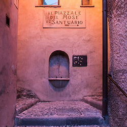 Colorful architecture and narrow streets with steps in Santa Maria Del Monte in Varese, Italy illminated at dusk