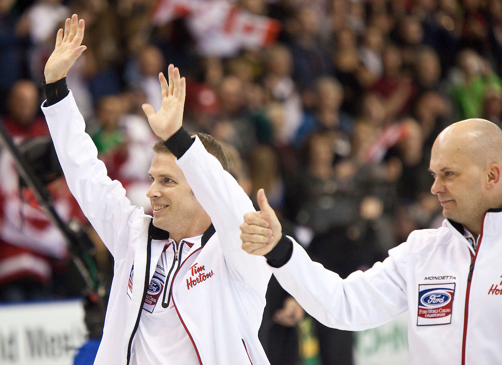 Canadian skip Jeff Stoughton, left, and third Jon Meadcelebrate their victory over Scotland in the gold medal game at the Ford World Men's Curling Championships in Regina, Saskatchewan, April 10, 2011.<br /> AFP PHOTO/Geoff Robins