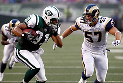 Aug 14, 2009; East Rutherford, NJ, USA;  New York Jets tight end Dustin Keller (81) makes a catch and eludes St. Louis Rams linebacker Chris Chamberlain (57)  during the first half at Giants Stadium.