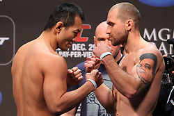 Las Vegas, NV - December 28, 2012: Yushin Okami and Alan Belcher weigh in for their main card bout at UFC 155 at MGM Grand Garden Arena in Las Vegas, Nevada.