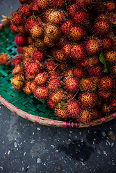Basket filed with rambutan fruits, Hanoi, Vietnam, Southeast Asia
