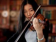 Westover School-December 2012- Qing Wang playing violin (Photo by Robert Falcetti)