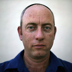 """Yuda Gross, 46, a shopkeeper and resident of the Gush Katif settlements, is seen in Gaza, Palestinian Territories, Nov. 4, 2004. When asked his thoughts about leaving the settlements Gross responded, """"I feel strong and that the truth is with me. If you believe you are right, everything will continue."""" Israel's parliament recently supported compensation payments for Jewish settlers leaving the Gaza Strip, in a vital vote for Prime Minister Ariel Sharon's plan to evacuate the occupied territory."""