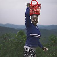 Young woman carrying groceries, Rwanda.