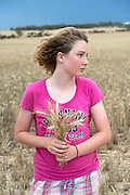 12 year old Pippa Reilly on her family's wheat field (paddock) with friend, Wyalkatchem, Western Australian Wheatbelt. 09 December 2012 - Photograph by David Dare Parker