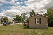 Fairview Montana, housing and grain elevator, despite Bakken Oil Field bust agricultural business remains viable