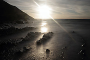 Sunset over the rocks as the tide comes in at Crackington Haven, North Cornwall