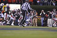 Ole Miss' Jeff Scott (3) runs vs. Auburn at Jordan-Hare Stadium in Auburn, Ala. on Saturday, October 29, 2011. .