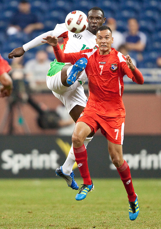 GR8006 -20110607- Detroit, Michigan,USA<br /> Guadeloupe's Jean-Luc Lamboirde and Panama's Blas Perez jump for a ball during their CONCACAF match at Ford Field in Detroit Michigan, June 7, 2011.<br /> AFP PHOTO/Geoff Robins