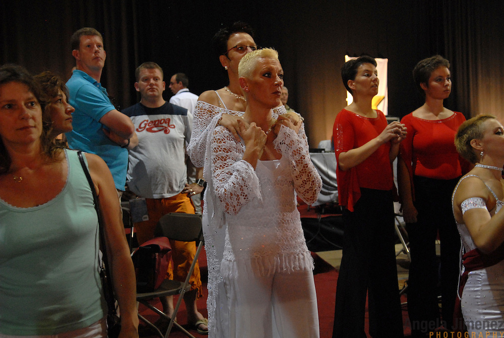 """Sonja Godee, center front, (accent on the first """"e"""" in Godee) and Monique Stroes, both of Holland, watch the competition between dances in the adult women's standard division of the same-sex ballroom dancing competition during the 2007 Eurogames at the Waagnatie hangar in Antwerp, Belgium on July 14, 2007. ..Over 3,000 LGBT athletes competed in 11 sports, including same-sex dance, during the 11th annual European gay sporting event. Same-sex ballroom is a growing sports that has been happening in Europe for over two decades."""