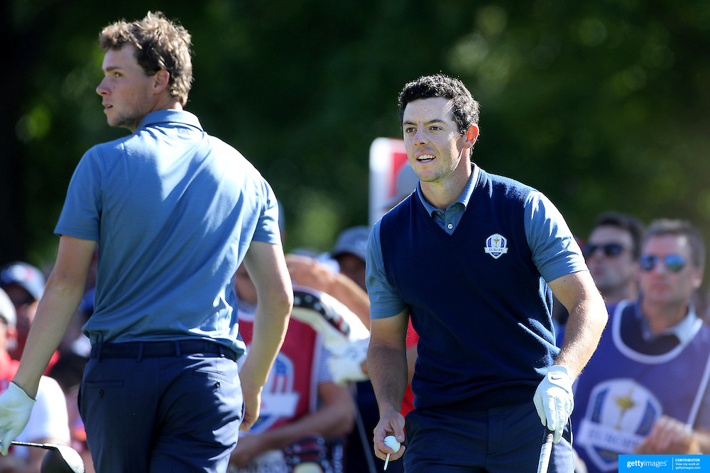Ryder Cup 2016. Day One. Rory McIlroy of Europe prepares to tee off watched by team mate Thomas Pieters of Europe on the sixth in the Friday afternoon four-ball competition during the Ryder Cup at  Hazeltine National Golf Club on September 30, 2016 in Chaska, Minnesota.  (Photo by Tim Clayton/Corbis via Getty Images)