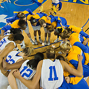 Elena Delle Donne (11) and her University Delaware teammates huddles together prior to the start of an NCAA college basketball game against George Mason Thursday, Feb. 23, 2012, at the Bob Carpenter Center in Newark, Del. (AP Photo/Saquan Stimpson)
