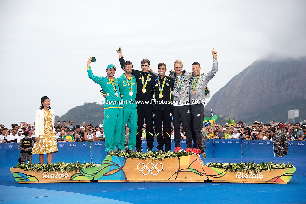 From Left: Australia's Nathan Outteridge Iain Jensen Silver, Peter Burling and Blair Tuke Gold and Germany's Erik Heil and Thomas Ploessel Bronze during the Men's 49er class sailing race medal ceremony at the 2016 Rio Olympics on Thursday the 18th of August 2016. © Copyright Photo by Marty Melville / www.Photosport.nz