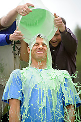 Journeys School Head of School Nate McClennen is one of three educators covered in slime Tuesday by students who earned the privilege by organizing a high level of participation in Old Bill's Fun Run.
