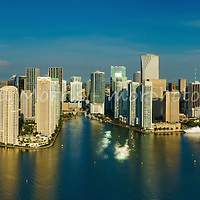 This version is watermarked, contact us to license and clean version. Aerial panorama of downtown Miami from the east over Biscayne Bay, featuring Bayfront Park, Bayside, the entrance to the Miami River, Brickell and Brickell Key.