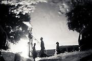 Reflection of pedestrians near Sule Pagoda, Yangon, Myanmar,  May 17th 2013