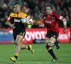Chiefs' Sona Taumalolo is chased by Crusaders' Richie McCaw in a Super Rugby match, Waikato Stadium, Hamilton, New Zealand, Friday, July 06, 2012.  Credit:SNPA / David Rowland