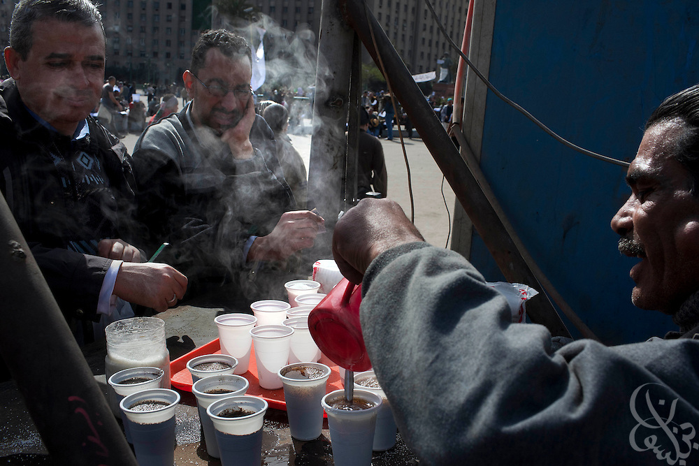 Egyptian protesters start off their morning in Tahrir square purchasing cups of tea from a vendor February 03, 2011 in Cairo, Egypt. Protesters have occupied the square for a week and have managed to maintain small but  regular supplies of food, beverages, medical supplies and newspapers.  (Photo by Scott Nelson).