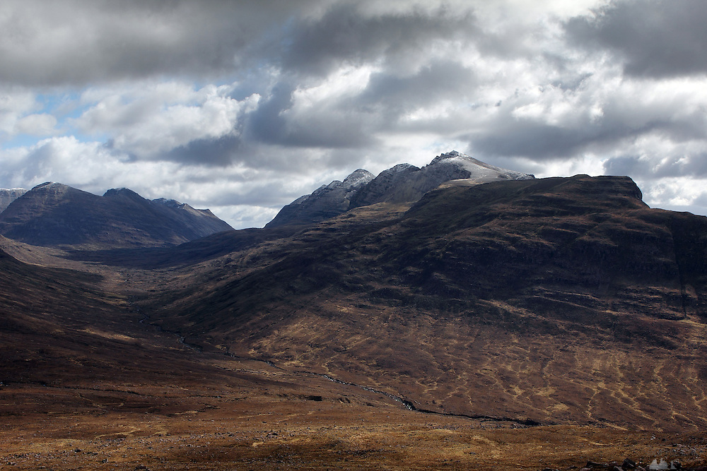 Hiking up from Torridon towards the Tom na Gruagaich munro, one of the peaks that comprise Beinn Alligin, in the Scottish Highlands. This is the view across to Liathach.