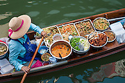Food vendor at Damnoen Saduak Floating Market in Ratchaburi, Thailand.