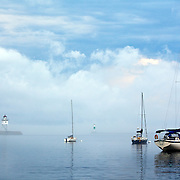 .A view of Grand Marais Harbor and Lake Superior in Grand Marais, Minnesota,  one of the gateways to the Boundary Waters Canoe Area Wilderness in the Superior National Forest in Northern Minnesota.