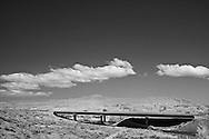 Red Mountain, Washington.  Infrared (IR) photograph of desert scene with clouds overlooking interstate I82 near Benton City, WA.  Landscape photography by Michael Kloth. Black and white infrared photographs