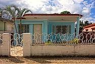 House and fence in Moron, Ciego de Avila, Cuba.