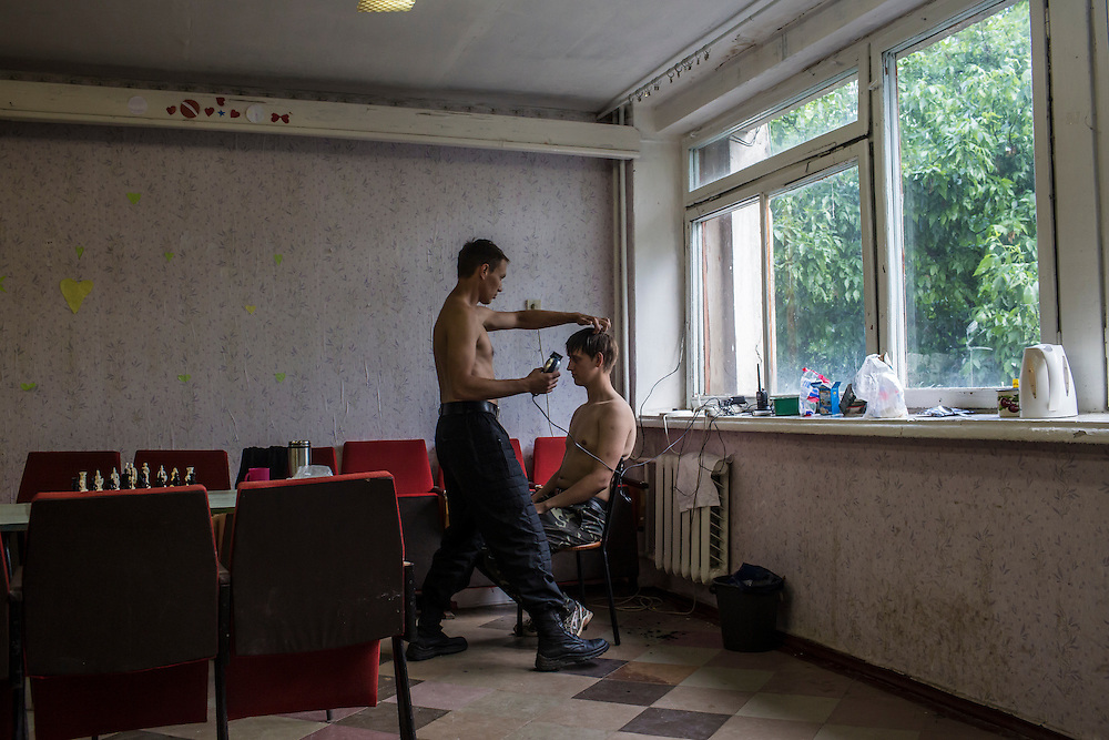 A new recruit has his hair cut at a training camp for the Donbass Battalion, a pro-Ukrainian militia, on May 19, 2014 in Dnipropetrovsk Region, Ukraine. A week before presidential elections are scheduled, questions remain whether the eastern regions of Donetsk and Luhansk are stable enough to administer the vote.