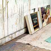 Paintings on the floor of an artists studio