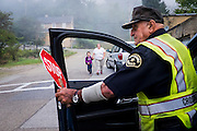 Crossing guard Frank Cangiano, 85, keeps a watchful eye as children walk along the streets of the McDonald Heights neighborhood of Aliquippa, Pennsylvania, USA on their way to catch the school bus on September 17, 2015. <br /> <br /> Since 1987, the city has been designated as a distressed municipality under the state's Act 47, a law that created a recovery program that's helped some 29 municipalities in the state stay afloat.<br /> <br /> The city now has fewer residents now than the local steel mill  had employees (14,000) in its heyday. The mill closed down for good 20 years ago. <br /> <br /> The result has been a spiral or residents leaving and businesses closing down.<br /> <br /> With the lack of good jobs, there is not much in the way of opportunites for the youth of the city.
