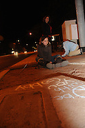 A memorial was created outside of the office of Arizona Congresswoman, Gabrielle Giffords, who is recovering from a gunshot wound to the head that she sustained on January 8, 2011, in Tucson, Arizona, USA.  Six people died in the attack outside of a grocery store. Casey Norris, 10, sits on the sidewalk outside of the office after wruting a message with chalk to Giffords.