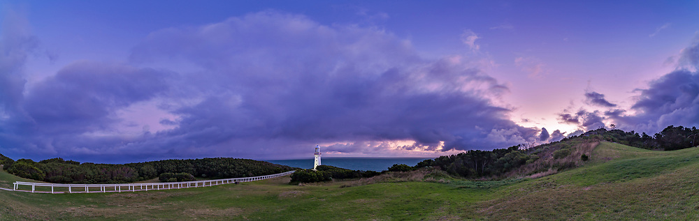 Evening twilight at the Cape Otway Lighthouse on the Great Ocean Road, Victoria, Australia. Built in 1848, Otway served as a major &ldquo;landfall light&rdquo; for arriving immigrant ships. Even so, dozens of ships ran aground threading the needle&rdquo; between the mainland and King Island at the western end of Bass Strait. <br /> <br /> At far right is a concrete WWII gun emplacement. <br /> This is a 5-segment panorama with the 14mm lens and Canon 6D. Stitched with Adobe Camera Raw.