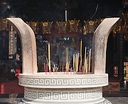 Incense burning in stone urn,  Nghia An Hoi Quan Pagoda on 678 Nguyen Trai Street in Cholon, Ho Chi Minh City
