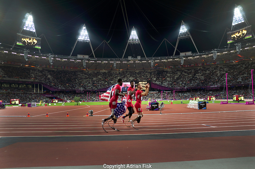 The USA 4x100m paralympic T44 team celebrate coming second. Minutes later their disqualification due to bad baton passing was announced