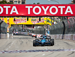 LONG BEACH, CA - APR 19: Indycar Driver Danica Patrick at start/finish line drives the #7 Motorola Andretti Green Racing Dallara Honda during the IRL IndyCar Series Toyota Grand Prix of Long Beach 2009 on the streets of Long Beach, California. Photo by Eduardo E. Silva