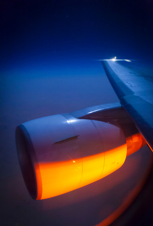 Engine cowling illuminated by moonlight and the aircraft belly strobe.