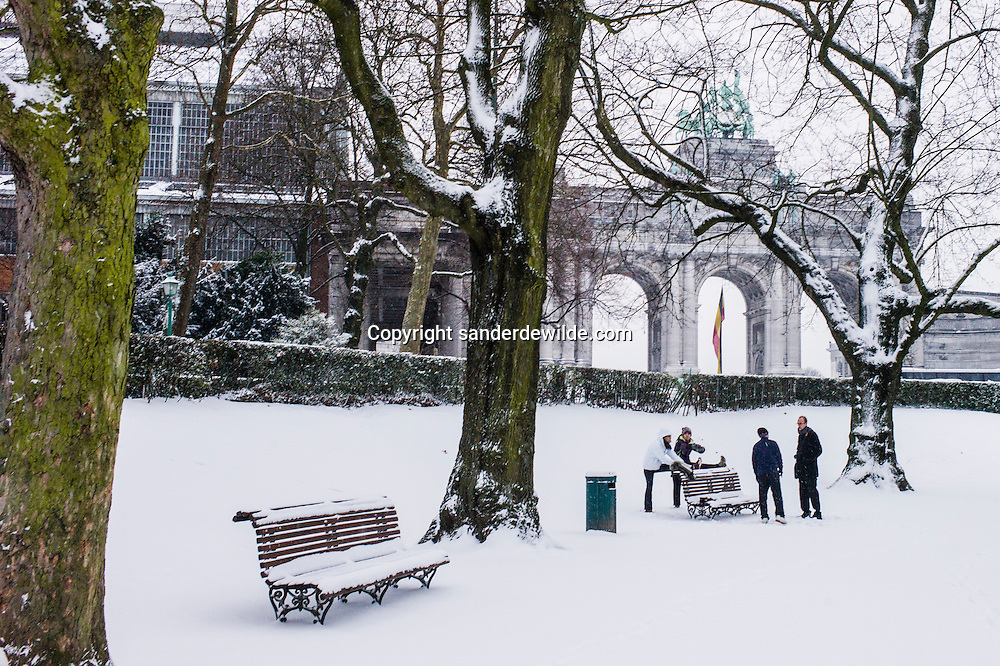 Belgium Brussels 2013 january 15 snow falls in Europe. Chinese stretch their legs in the snow covered park of Brussels, called Jubelpark