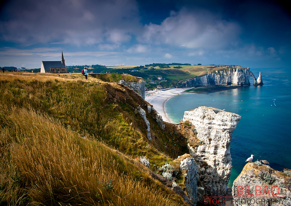 Cliffs, natural arch and stone beach.<br /> Etretat, Le Havre, Seine-Maritime, Normandy, France