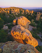 0103-1027 ~ Copyright: George H. H. Huey ~ Standing rocks at sunrise in Heart-of-Rocks area. Chiricahua National Monument, Arizona.