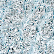 Meltwater pools within crevasses created by the melting and subsequent stretching of the Greenland ice sheet, 55km east of Ilulissat, August, 2014.