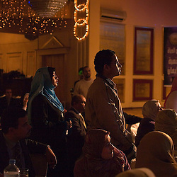 Students listen as Amr Khaled, an Islamic televangelist, addresses his followers at a Life Makers gathering inside a local wedding hall, Alexandria, Egypt, Dec. 23, 2005. Khaled had previously been asked to leave Egypt as his revival gained strength. As a result he started preaching on several television shows, turning him into an international celebrity.