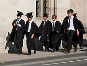 Boy choristers from Magdalen College School below Magdalen Great Tower, Oxford High Street, England
