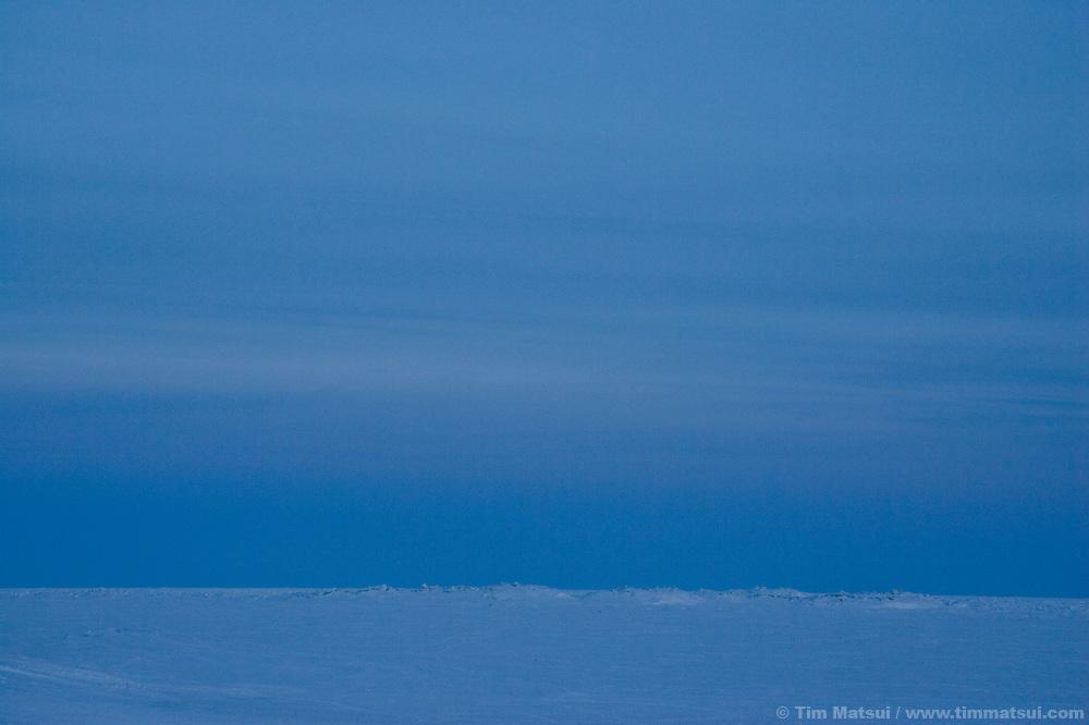 Pack ice stretches to the horizon outside the rural Inupiat Eskimo village of Kivalina, Alaska.