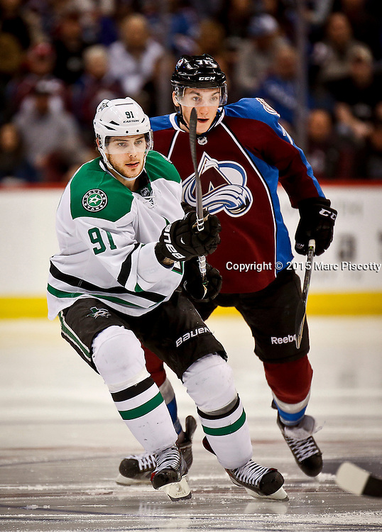 SHOT 1/10/15 4:03:13 PM - The Colorado Avalanche's Boma Rendulic #71 chases after the Dallas Stars' Tyler Seguin #91 during their regular season game at the Pepsi Center in Denver, Co. Colorado won the game 4-3.  (Photo by Marc Piscotty / © 2015)